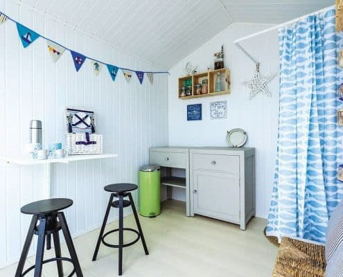 inside an osea beach hut set made from Cedral Weatherboard