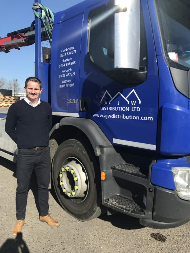Image of a man standing next to a lorry