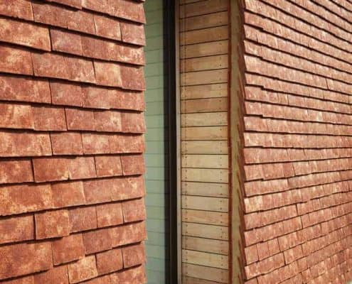 Closeup of handmade roof tiles and window detail of Caring Wood, winner of RIBA House of the Year award 2017