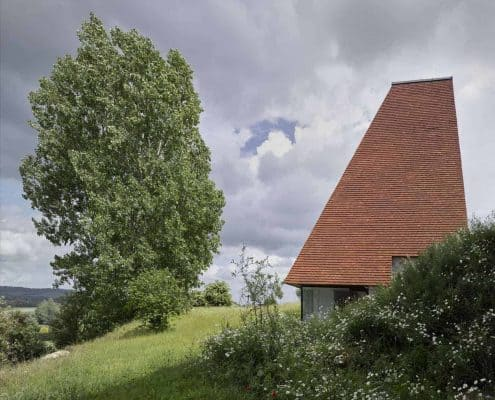 Part of Caring Wood estate, inspired by a traditional oast house using handmade roof tiles