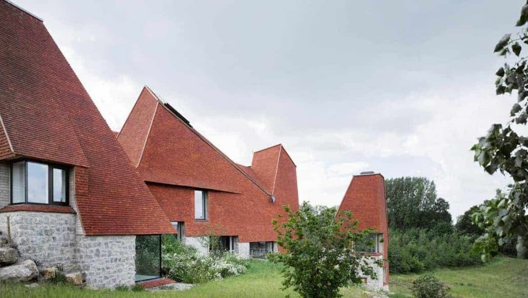 Side view of Caring Wood, winner of RIBA 2017 House of the Year award with stunning handmade roof tiles